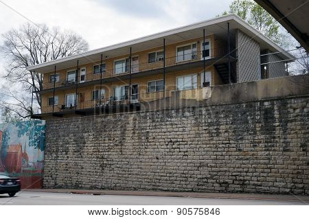 Apartment Building Above a Wall