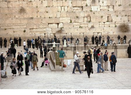 Jews being prayed at the Western Wall in Jerusalem