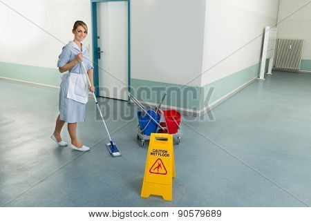 Female Janitor Cleaning Floor