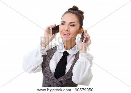 Business woman in her office on two phones at the same time