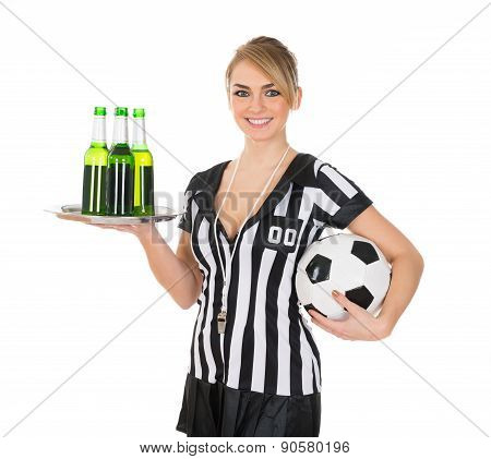 Referee Holding Drinks And Football