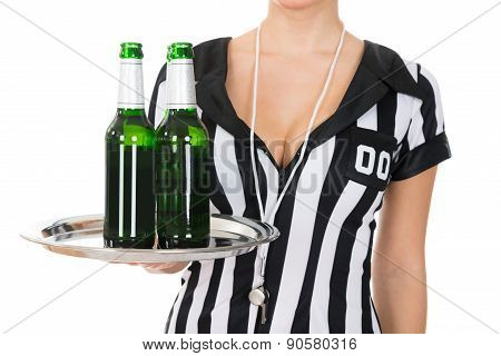 Close-up Of Referee Holding Drinks
