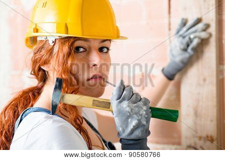 Woman Bricklayer with Hammer