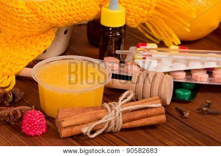 Close up of honey and pills
