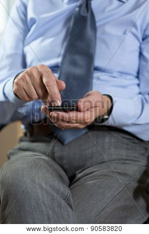 Elder Man Using Mobile Phone