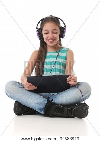 Beautiful pre-teen girl using a tablet computer