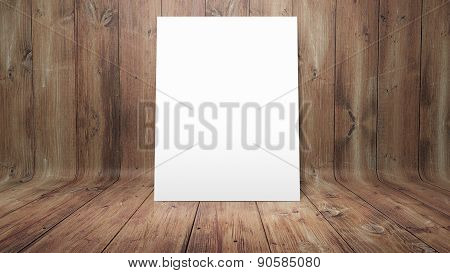 White poster on curved wooden background