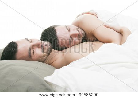 A homosexual couple onder a bed in studio white