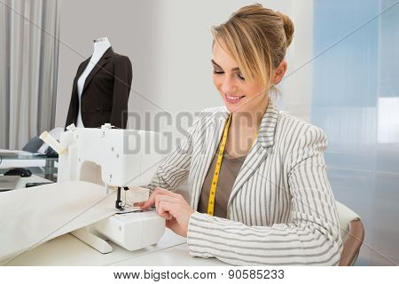 Beautiful Fashion Designer Working On Sewing Machine