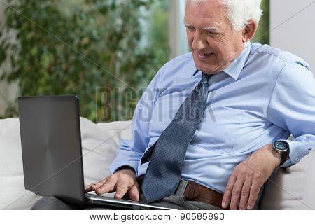 Senior Man With A Laptop