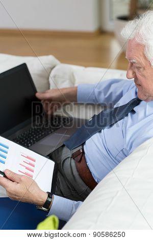 Senior Man Analyzing A Chart