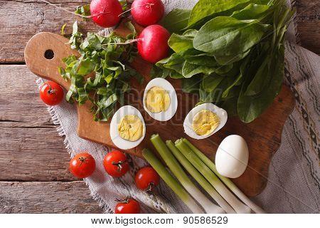 Egg, Sorrel, Radishes And Tomatoes. Horizontal Top View