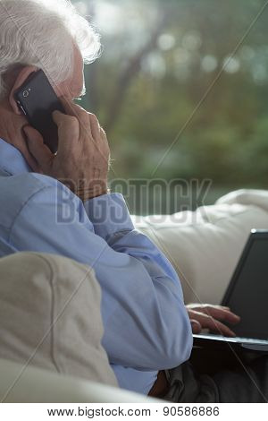 Senior Businessman Using Technology
