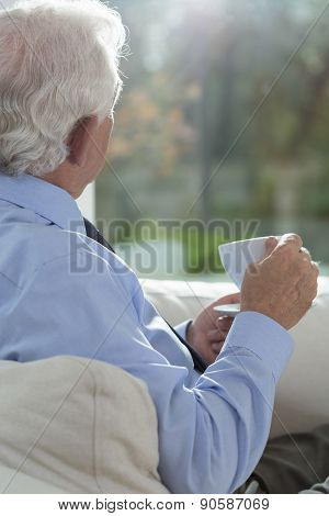 Senior Man Relaxing With Coffee