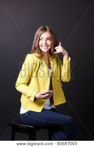 Happy Woman Showing A Call Me Sign