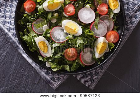 Delicious Salad With Eggs, Radishes And Sorrel Top View
