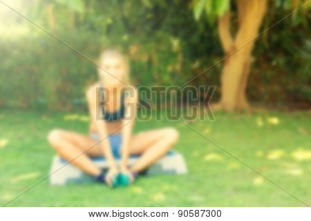Young Woman During Her Outdoor Step Workout. Abstract Blur Background With Bokeh