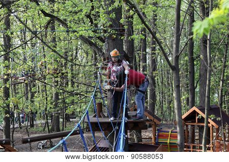 Couple On A Rope Climbing