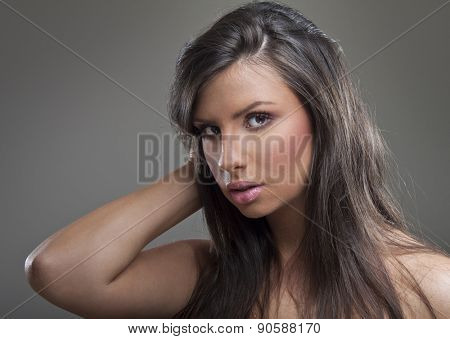 Adorable young brunette woman long hair posing in studio