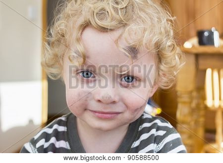 Little Boy Whose Face  Is Smudged With Paint