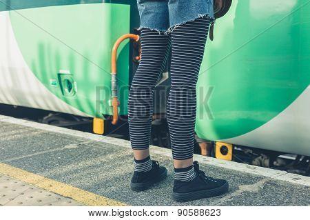 Woman Standing On Train Platform