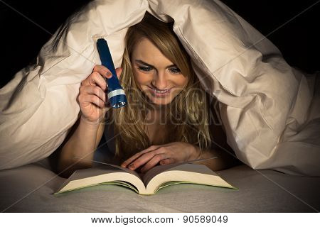 Woman Reading Book Holding Torch