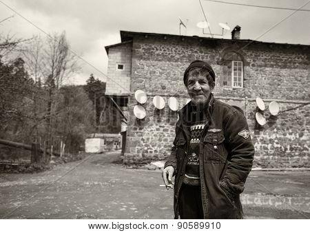 Abastumani, GEORGIA - MAY 05, 2015: Black and white portrait of a homeless old man