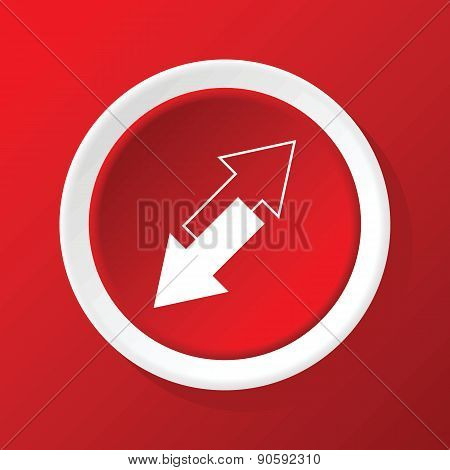 Tilted arrows icon on red