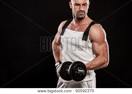 Hispanic Young Muscular Man Doing Heavy Dumbbell Exercise For Biceps.