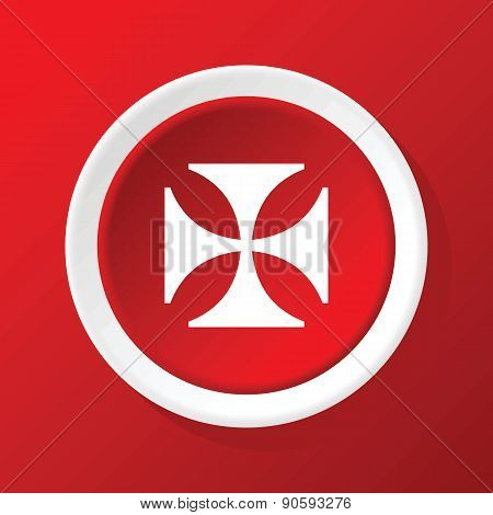 Maltese cross icon on red