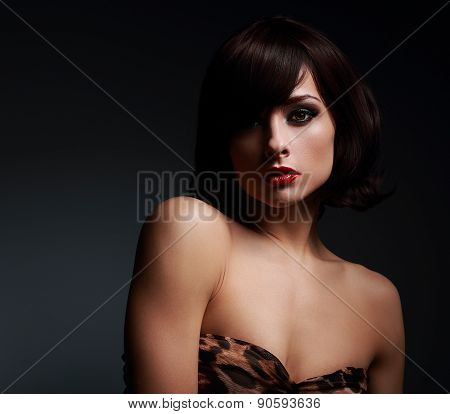 Sexy Short Hair Woman With Bright Makeup On Dark Background