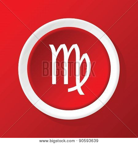 Virgo icon on red