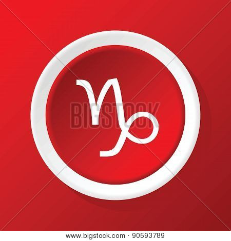 Capricorn icon on red