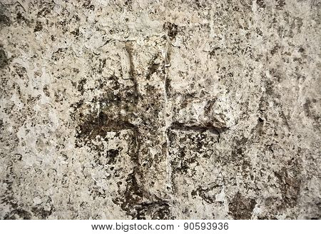 Ancient Cross On The Stone Wall. Background