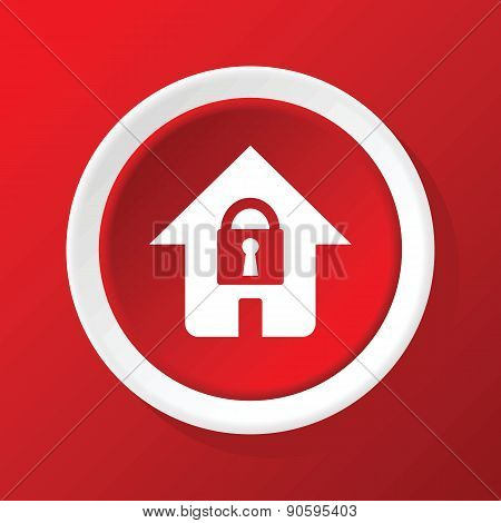 Locked house icon on red