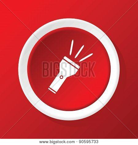 Flashlight icon on red