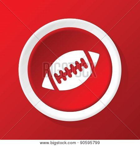 Rugby ball icon on red