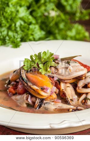 Cooked Mussels In Tomato Sauce.