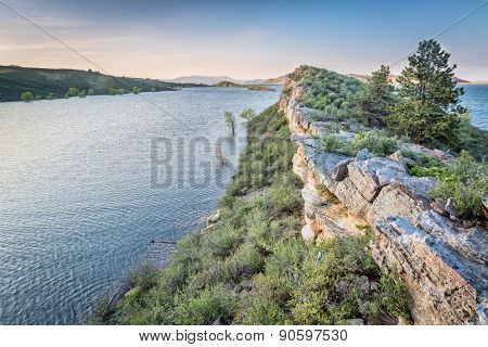 sandstone cliff and lake at dusk - Horsetooth Reservoir near Fort Collins, Colorado, at springtime
