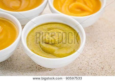 organic fruit and vegetable baby food or snack (apple, pea, spinach, corn, sweet potato, grape, peach) - ceramic bowls on white painted barn wood