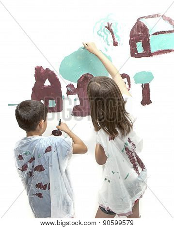 Siblings Working On The Picture.