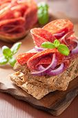 foto of crisps  - Crisp bread with salami and red onion - JPG