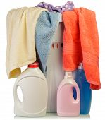 image of detergent  - Detergent and towels in basket on pale background - JPG