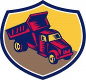 image of dump_truck  - Illustration of a dump truck viewed from high angle set inside shield crest done in retro woodcut style - JPG