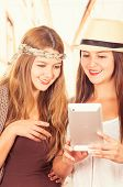 stock photo of bff  - Beautiful young smiling trendy girls using tablet - JPG