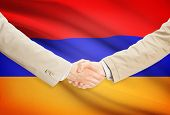 image of armenia  - Businessmen shaking hands with flag on background  - JPG