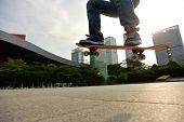 foto of skateboarding  - skateboarder doing skateboarding trick ollie on city - JPG
