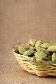pic of cardamom  - Green Cardamom pods in bamboo basket on sack cloth  - JPG