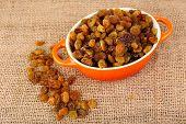 foto of sackcloth  - Raisins in pan on sackcloth - JPG