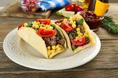 pic of tacos  - Mexican food Taco in plate on wooden table - JPG